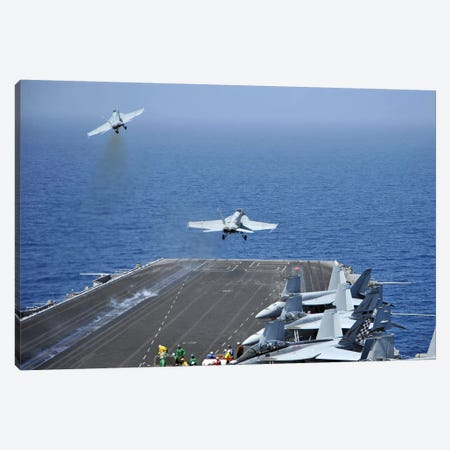F/A-18F Super Hornets Launch From The Aircraft Carrier USS Enterprise Canvas Print #TRK799} by Stocktrek Images Canvas Print