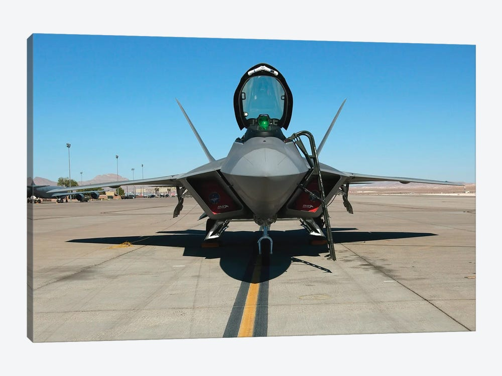 F/A-22 Raptor Sits On The Parking Ramp by Stocktrek Images 1-piece Canvas Print