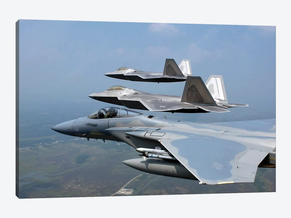 F-15 And F/A-22 Raptors Fly In Formation During A Training Sortie by Stocktrek Images 1-piece Canvas Print