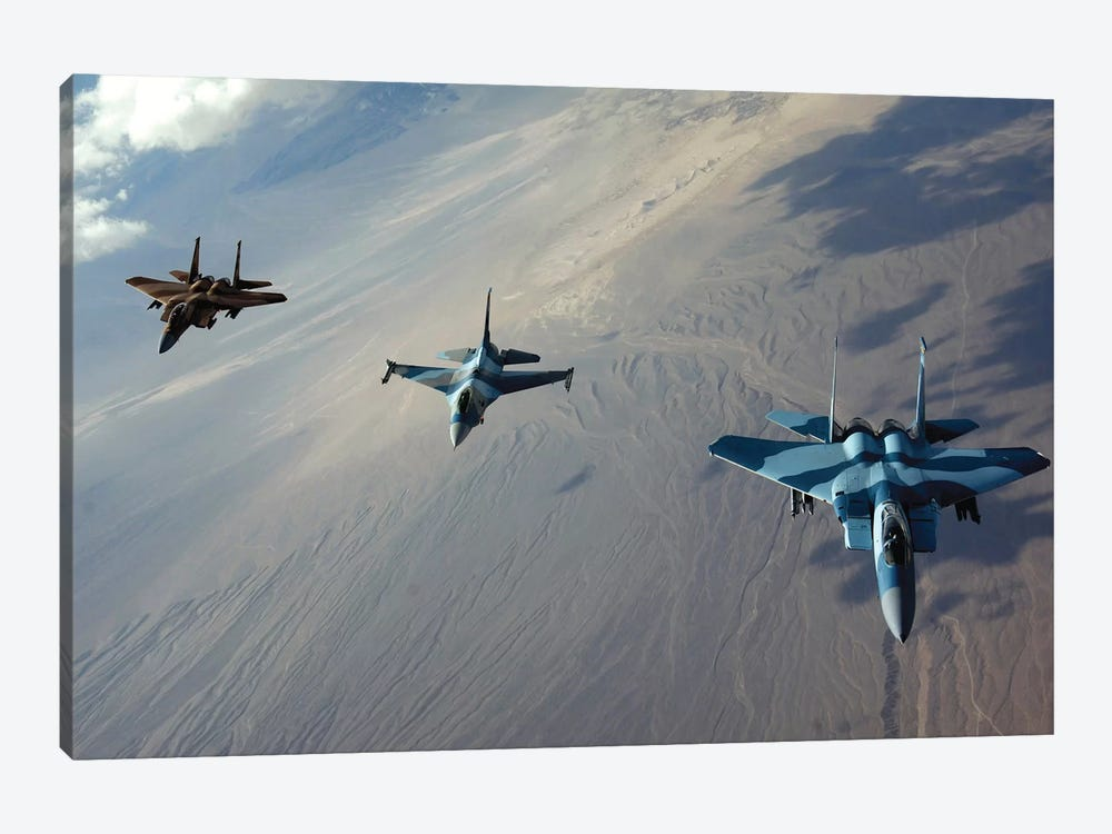 F-15 Eagles And A F-16 Fighting Falcon Fly In Formation by Stocktrek Images 1-piece Art Print