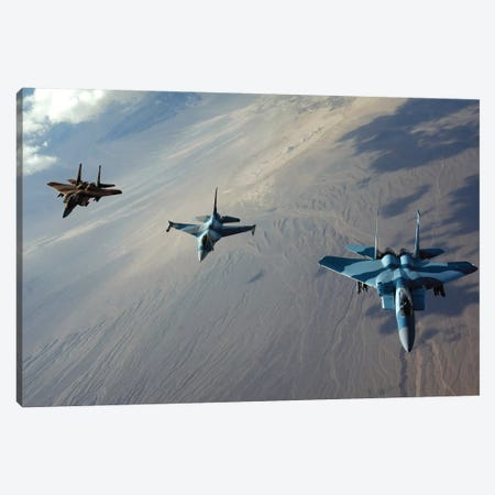 F-15 Eagles And A F-16 Fighting Falcon Fly In Formation Canvas Print #TRK807} by Stocktrek Images Canvas Artwork