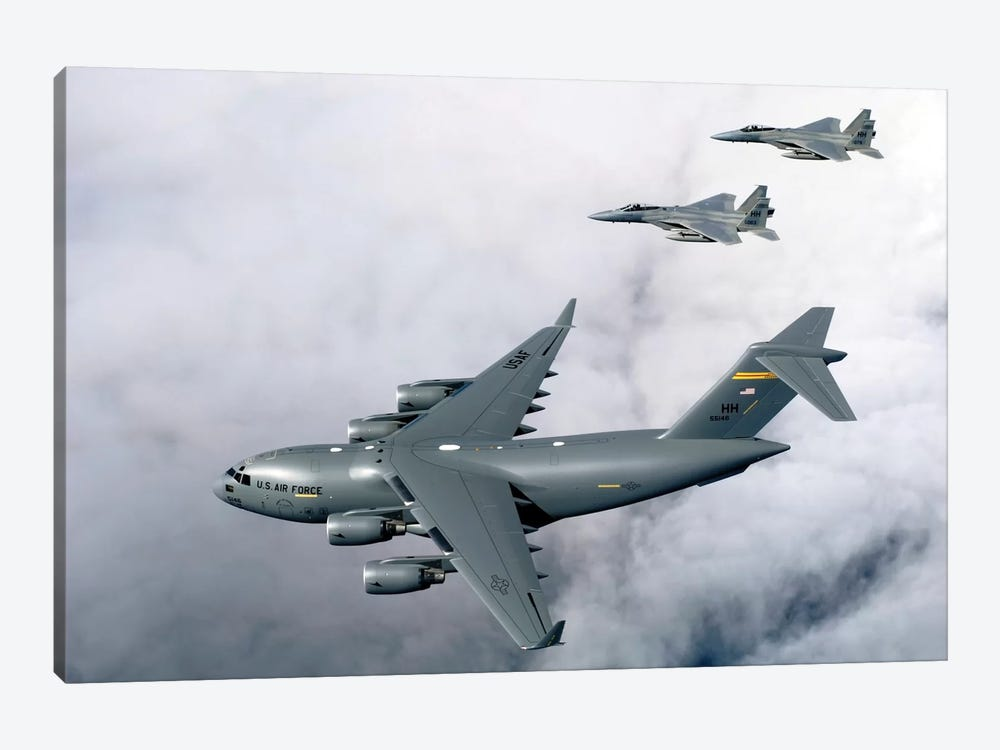F-15B Eagles Escort The First Hawaii-Based C-17 Globemaster III To Its Home II by Stocktrek Images 1-piece Canvas Art Print