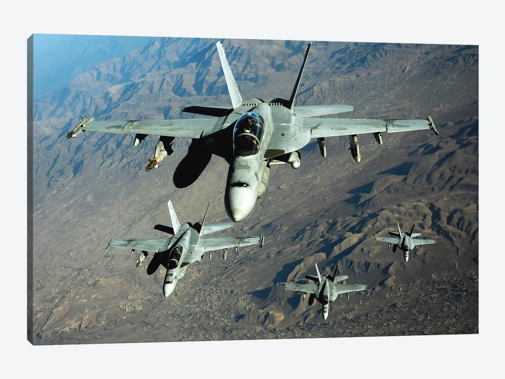 Four US Navy F/A-18 Hornet Aircraft Fly Over Mountains In Afghanistan by Stocktrek Images 1-piece Art Print
