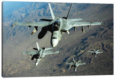 Four US Navy F/A-18 Hornet Aircraft Fly Over Mountains In Afghanistan Canvas Art Print