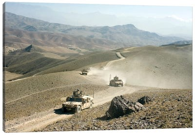 Humvees Traverse Rugged Mountain Roads Canvas Art Print