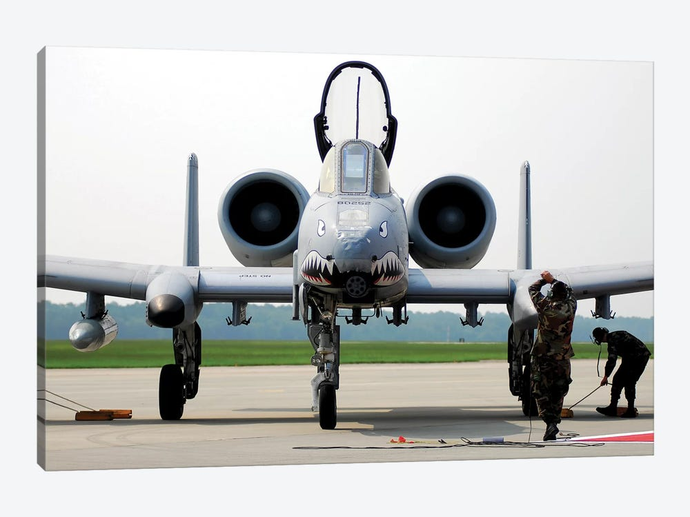 Maintainers Place The Chocks Under An A-10C Thunderbolt II by Stocktrek Images 1-piece Canvas Print