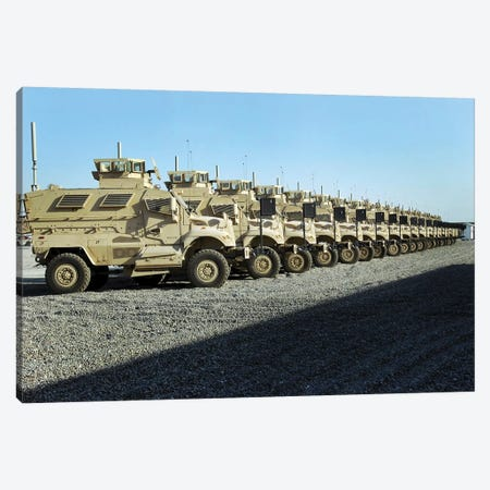 MaxxPro Mine Resistant Ambush Protected Vehicles Sit At Camp Liberty Canvas Print #TRK862} by Stocktrek Images Art Print