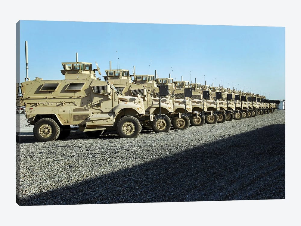 MaxxPro Mine Resistant Ambush Protected Vehicles Sit At Camp Liberty by Stocktrek Images 1-piece Canvas Artwork