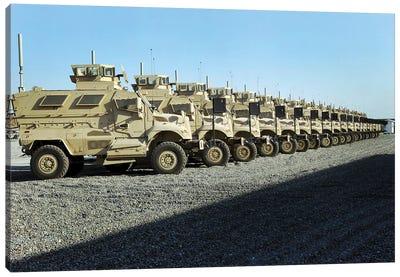 MaxxPro Mine Resistant Ambush Protected Vehicles Sit At Camp Liberty Canvas Art Print