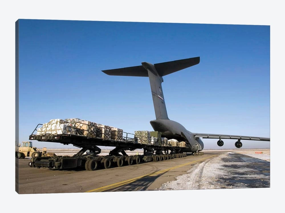 Pallets Await Loading Onto A C-5 Galaxy by Stocktrek Images 1-piece Canvas Print