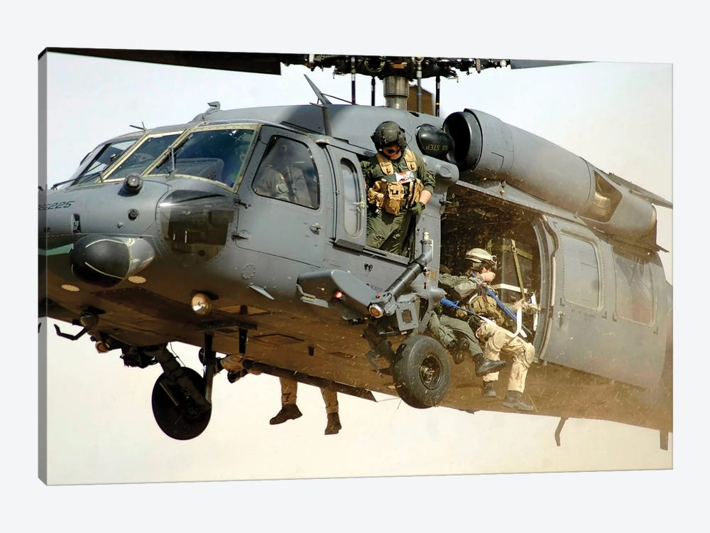 Pararescuemen Aboard A Helicopter Prepare For Landing by Stocktrek Images 1-piece Canvas Print