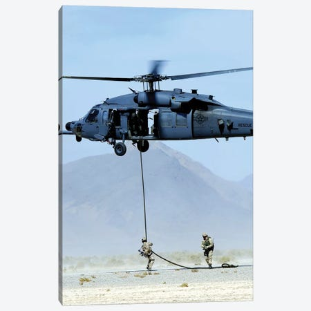 Pararescuemen Descend From An HH-60 Pave Hawk Helicopter Canvas Print #TRK873} by Stocktrek Images Canvas Wall Art
