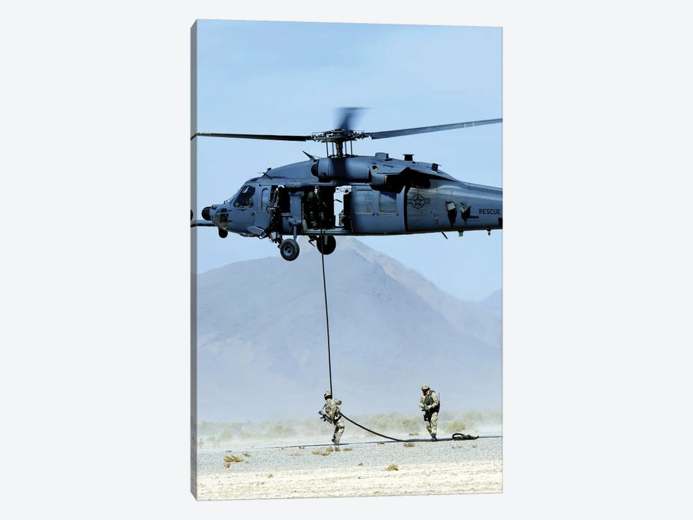 Pararescuemen Descend From An HH-60 Pave Hawk Helicopter by Stocktrek Images 1-piece Canvas Wall Art