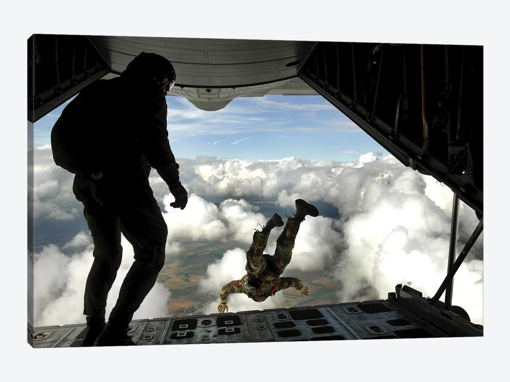 Pararescuemen Jump Out The Back Of A C-130 Hercules by Stocktrek Images 1-piece Canvas Print