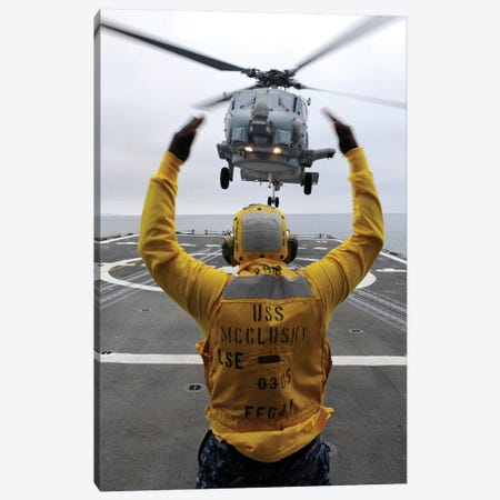 Petty Officer Guides An SH-60R Sea Hawk Helicopter Onto The Flight Deck Of USS McClusky Canvas Print #TRK878} by Stocktrek Images Canvas Artwork