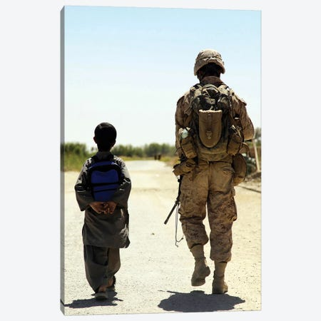 Rear View Of US Marine Walking Through Nawa Bazaar With An Afghan Boy In Afghanistan Canvas Print #TRK883} by Stocktrek Images Canvas Print