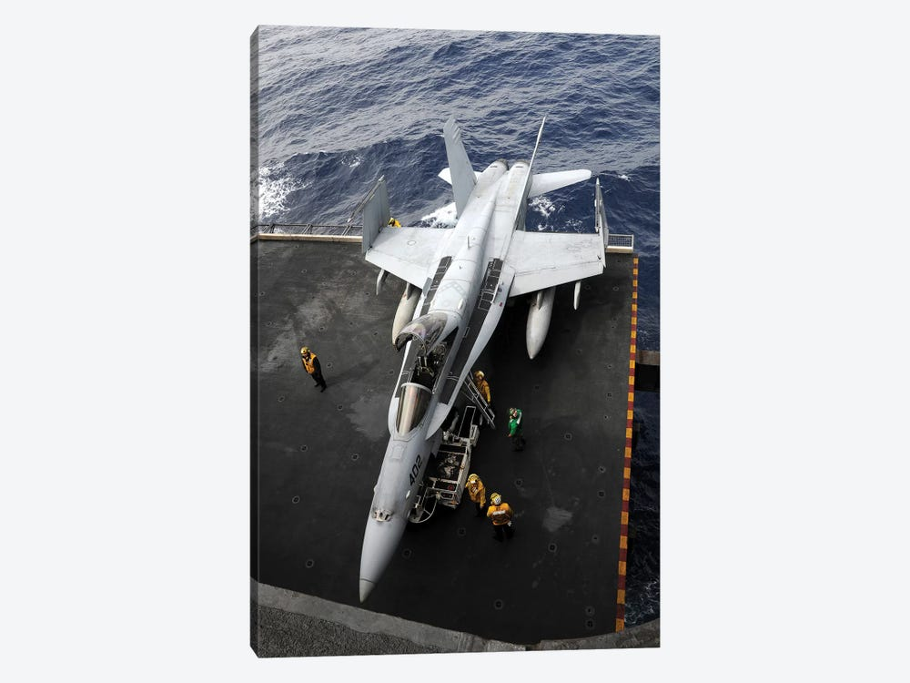 Sailors Move An F/A-18C Hornet Into The Hangar Bay by Stocktrek Images 1-piece Canvas Wall Art