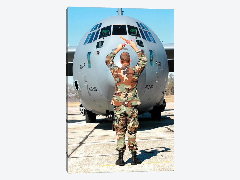 Senior Airman Guides C-130 Hercules Into Its Parking Spot 1-piece Canvas Wall Art