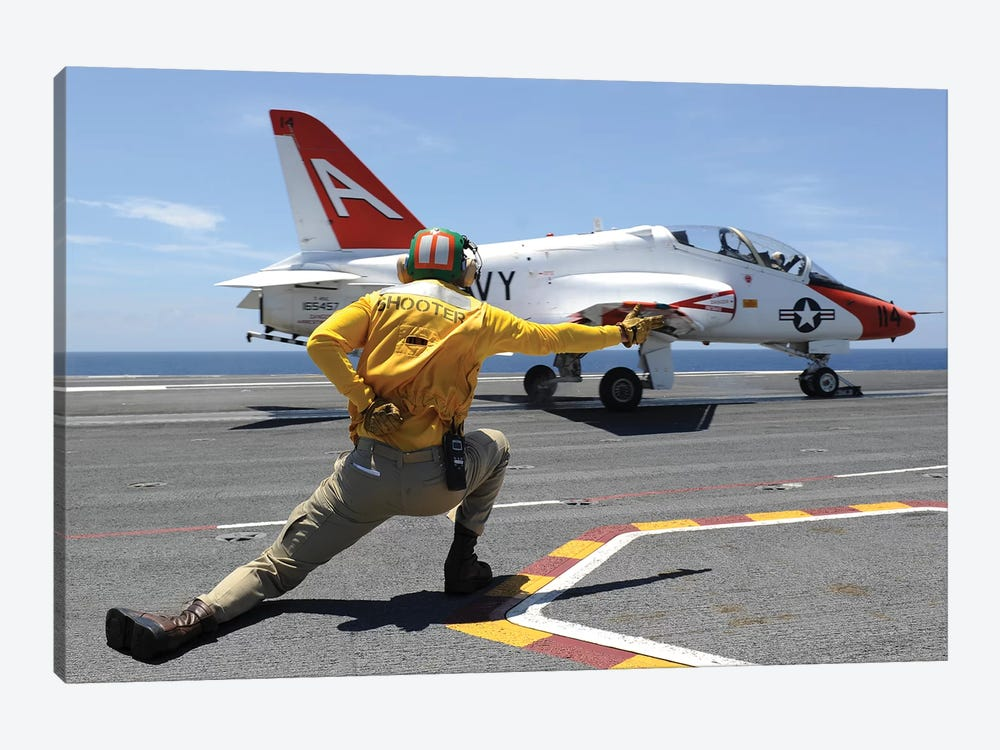 Shooter Signals To A T-45C Goshawk As It Launches From USS George HW Bush by Stocktrek Images 1-piece Canvas Print