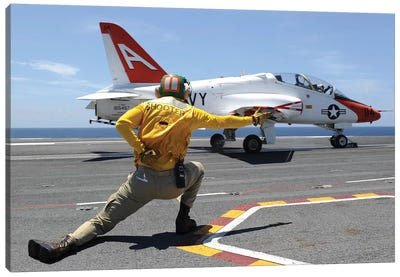 Shooter Signals To A T-45C Goshawk As It Launches From USS George HW Bush Canvas Art Print