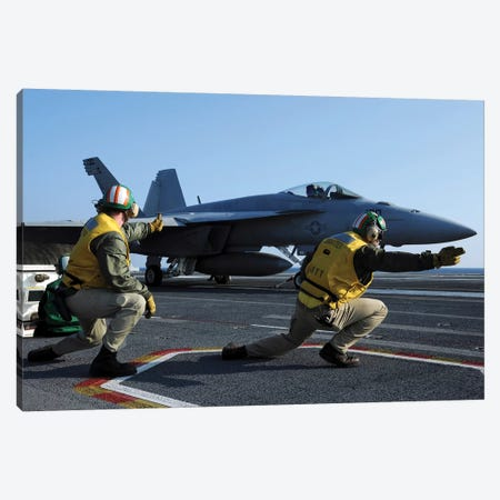 Shooters Aboard The USS George HW Bush Give The Go-Ahead Signal To Launch An F/A-18 Super Hornet Canvas Print #TRK901} by Stocktrek Images Canvas Artwork