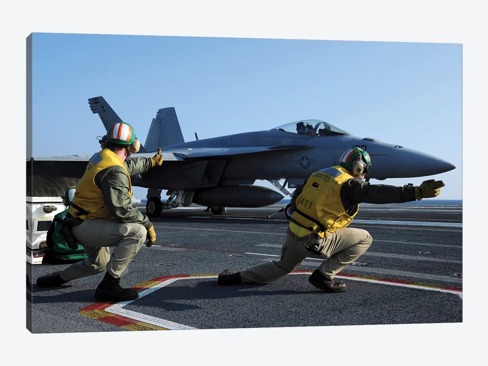 Shooters Aboard The USS George HW Bush Give The Go-Ahead Signal To Launch An F/A-18 Super Hornet by Stocktrek Images 1-piece Canvas Art