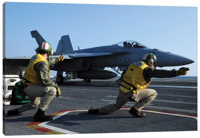 Shooters Aboard The USS George HW Bush Give The Go-Ahead Signal To Launch An F/A-18 Super Hornet Canvas Art Print