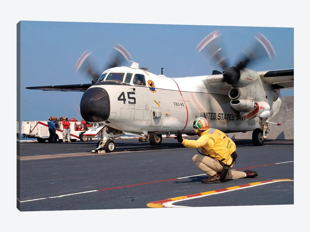 Signalman Gives The Launch Signal To A C-2A Greyhound by Stocktrek Images 1-piece Art Print