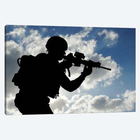 Silhouette Of A Soldier Against A Cloudy Sky Canvas Print #TRK903} by Stocktrek Images Canvas Wall Art