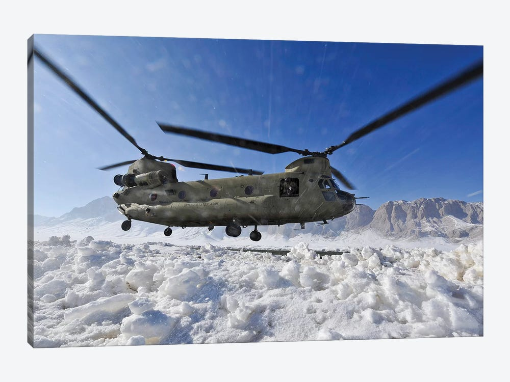 Snow Flies Up As A US Army CH-47 Chinook Helicopter Prepares To Land by Stocktrek Images 1-piece Canvas Artwork