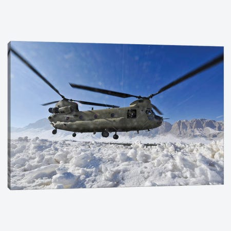 Snow Flies Up As A US Army CH-47 Chinook Helicopter Prepares To Land Canvas Print #TRK909} by Stocktrek Images Canvas Wall Art