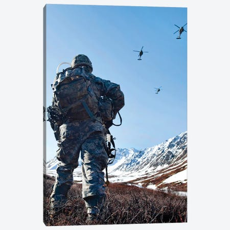 Soldier Patrols Through Alaska's Chugach Range As UH-60 Black Hawk Helicopters Fly Above Canvas Print #TRK912} by Stocktrek Images Canvas Print