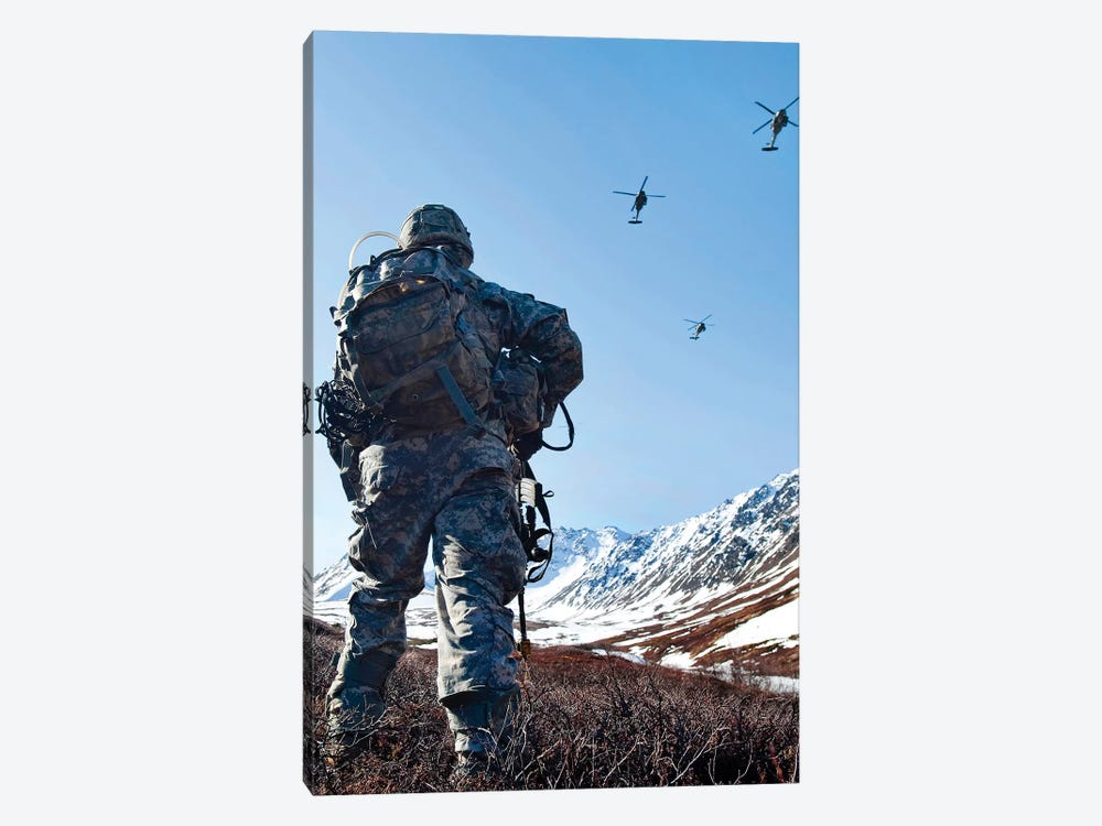 Soldier Patrols Through Alaska's Chugach Range As UH-60 Black Hawk Helicopters Fly Above by Stocktrek Images 1-piece Canvas Wall Art