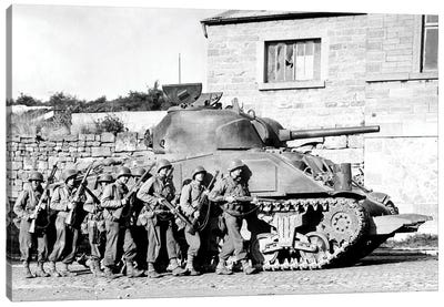 Soldiers And Their Tank Advance Into A Belgian Town During WWII Canvas Art Print
