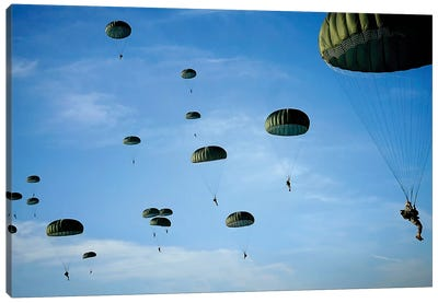 Soldiers Descend Under A Parachute Canopy During Operation Toy Drop Canvas Art Print