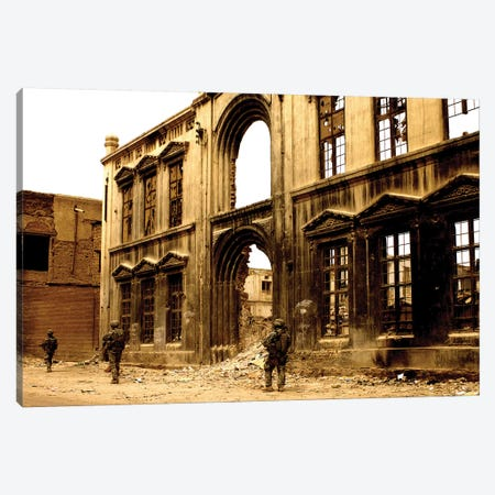 Soldiers Patrolling The Facade Of A Demolished Building In Baghdad, Iraq Canvas Print #TRK921} by Stocktrek Images Canvas Wall Art