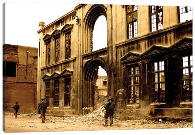 Soldiers Patrolling The Facade Of A Demolished Building In Baghdad, Iraq Canvas Art Print