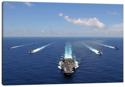 The USS Abraham Lincoln Leading A Formation Of Ships From The Abraham Lincoln Strike Group Canvas Art Print