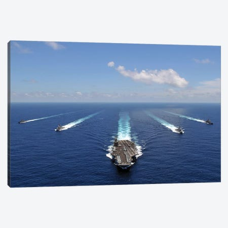 The USS Abraham Lincoln Leading A Formation Of Ships From The Abraham Lincoln Strike Group Canvas Print #TRK984} by Stocktrek Images Art Print