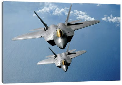 Two F-22 Raptors Fly Over The Pacific Ocean Canvas Art Print