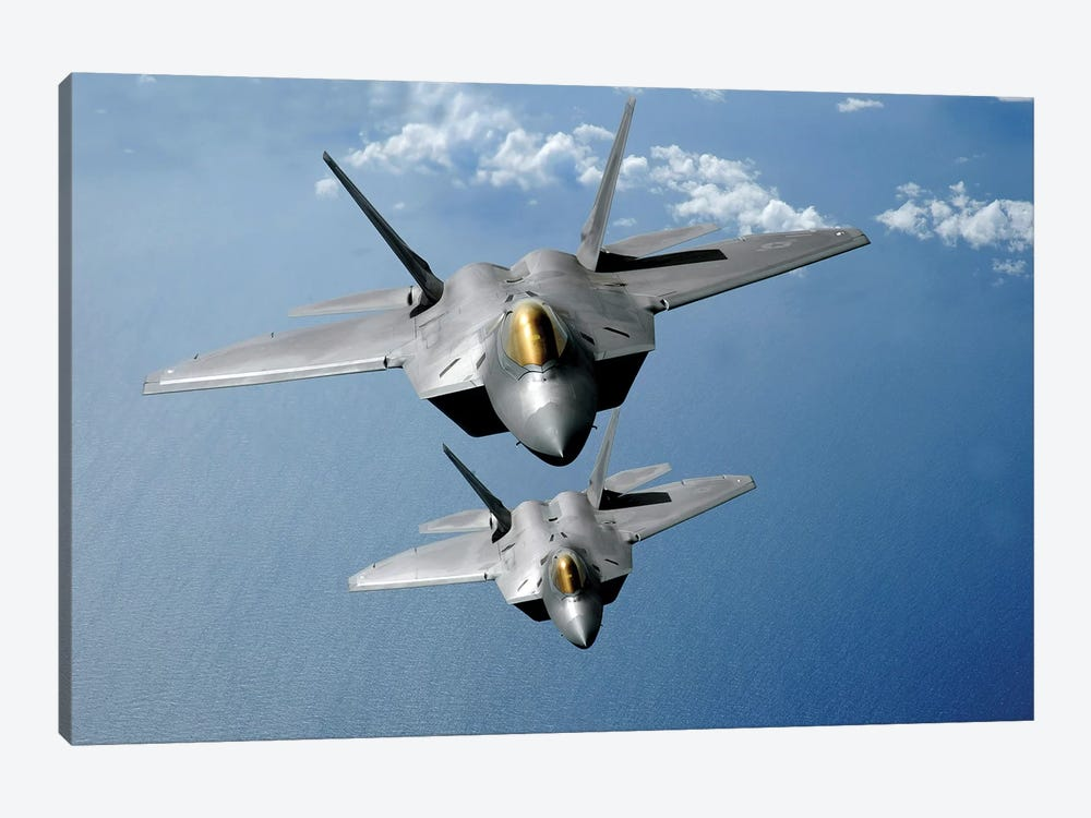 Two F-22 Raptors Fly Over The Pacific Ocean by Stocktrek Images 1-piece Canvas Art Print