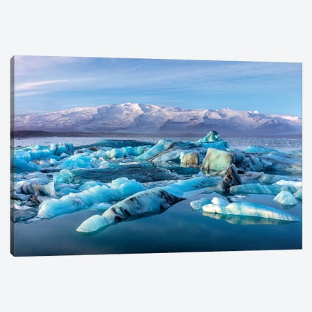 Calving icebergs in Jokulsarlon Glacier Lagoon in south Iceland Canvas Print #UCK28} by Chuck Haney Canvas Artwork