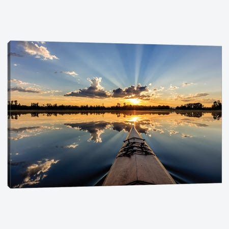 Kayaking into sunset rays on McWennger Slough, Kalispell, Montana, USA Canvas Print #UCK41} by Chuck Haney Canvas Artwork