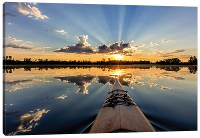 Kayaking into sunset rays on McWennger Slough, Kalispell, Montana, USA Canvas Art Print