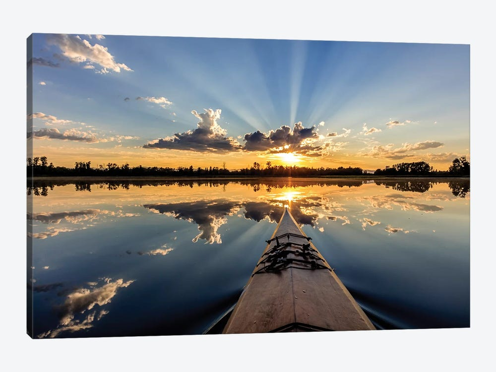 Kayaking into sunset rays on McWennger Slough, Kalispell, Montana, USA by Chuck Haney 1-piece Art Print