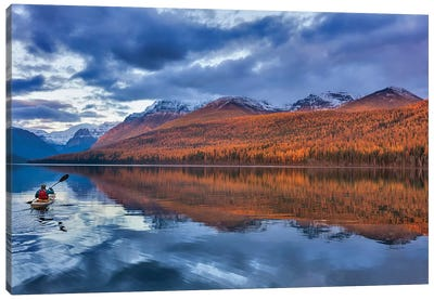 Sea kayaking on Bowman Lake in autumn in Glacier National Park, Montana, USA  Canvas Art Print