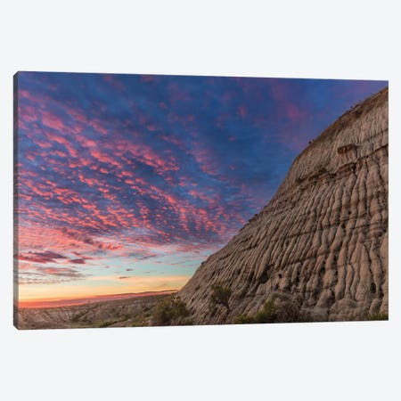 Vivid sunrise clouds over badlands formation in Theodore Roosevelt National Park, North Dakota, USA Canvas Print #UCK94} by Chuck Haney Canvas Wall Art
