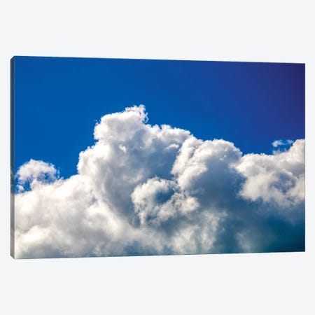 Gloomy dramatic cloudy blue sky background with fleecy curly soft white clouds. Canvas Print #VRY407} by Valery Rybakow Canvas Art Print