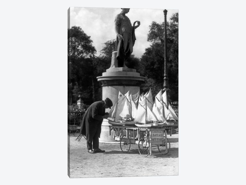 1930s Paris France Tuileries Gardens Man With Cart Of Miniature Toy Sailboats For Rent by Vintage Images 1-piece Art Print