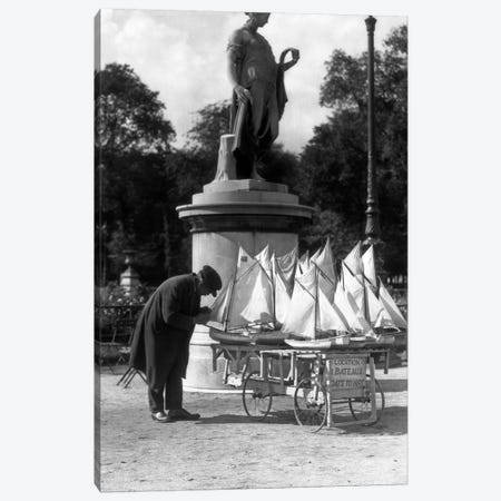 1930s Paris France Tuileries Gardens Man With Cart Of Miniature Toy Sailboats For Rent Canvas Print #VTG122} by Vintage Images Art Print